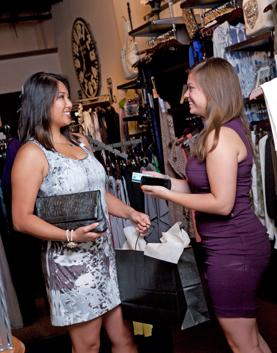 female sales associate making sale with mobile point of sale anywhere